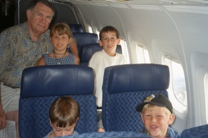 Dad and the grandkids prepare to fly to CA for the summer - circa 2000.
