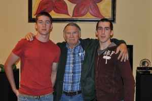 My dad with Gus and Dylan. Don't let the scowls fool you - apparently the boys have outgrown smiling for the camera. :)